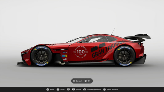 "7. Place the ""Mazda 100th Anniversary"" logo decal on the MAZDA RX-VISION GT3 CONCEPT body. The location of the decal is up to you."